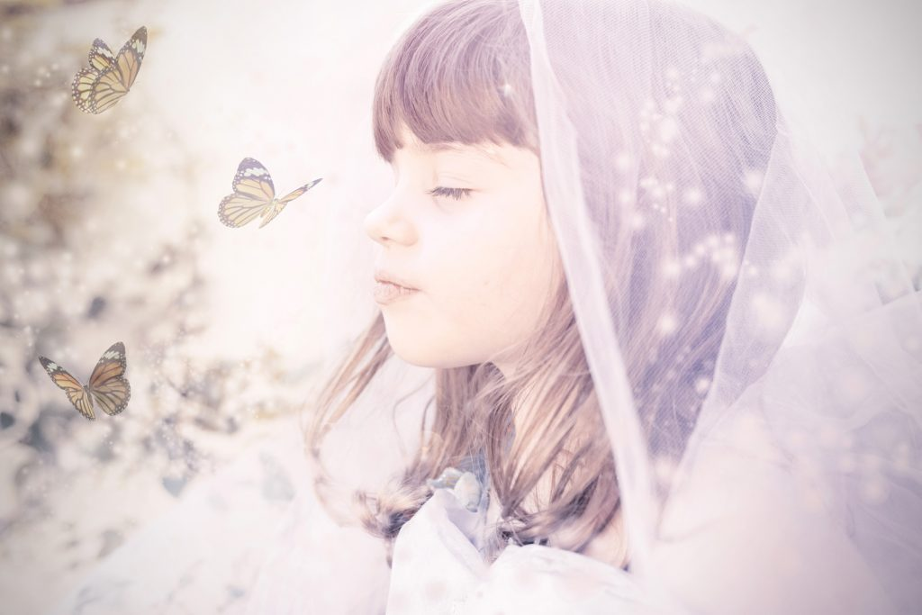 girl-child-portrait-veil-butterflies